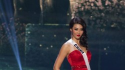Yanliang Hu, Miss China 2014 competes on stage in her evening gown during the Miss Universe Preliminary Show in Miami